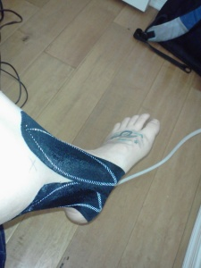 Taping my Post Tib with KT Tape - I'll probably have my leg taped up most of the time until after the marathon