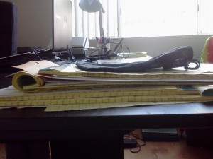 One of the piles of paper on my desk right now