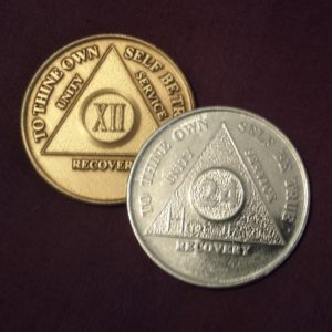 "I carry two chips in my wallet - my most recent birthday chip and my 24 hour ""desire"" chip. They remind me how far I've come but also that I have to take it one day at  time."