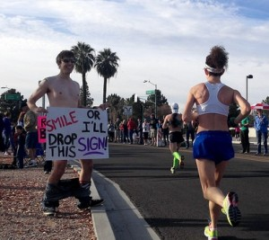 Funny marathon signs - Smile or it drops by Jeff Moriarty from Flickr, used with permission